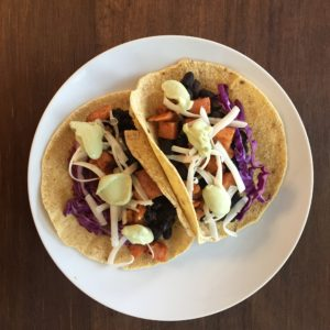 Black Bean and Sweet Potato Tacos with Avocado Crema